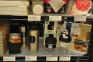 ... then, at the bottom, there's coffee-related kit, such as branded Keep Cups and filters.