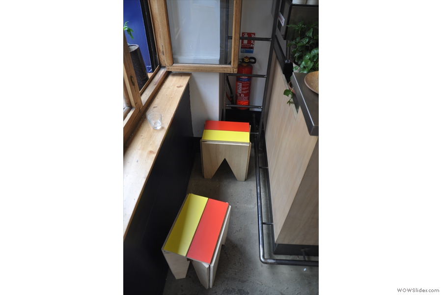 Two stools sqeezed into the space by the window. Check out the clever use of the windowsill as a table!