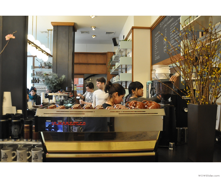 The counter is at the back, with an espresso machine facing you if you enter from the lobby.