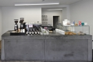 The front-on view: coffee to the left, till in the centre, cakes to the right.