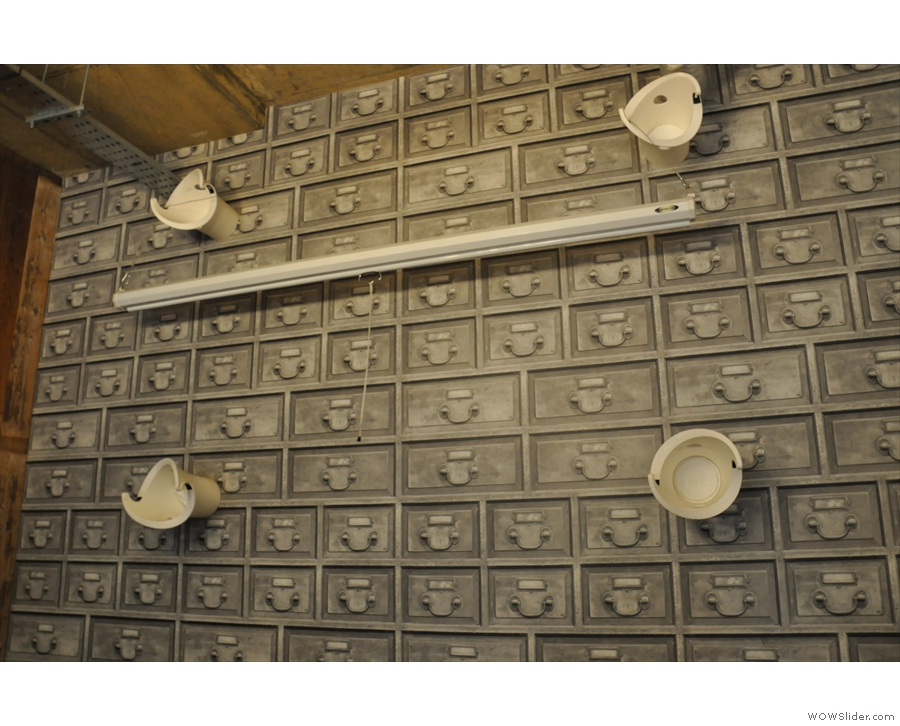 Check out the wall done out entirely in index-card file drawers...