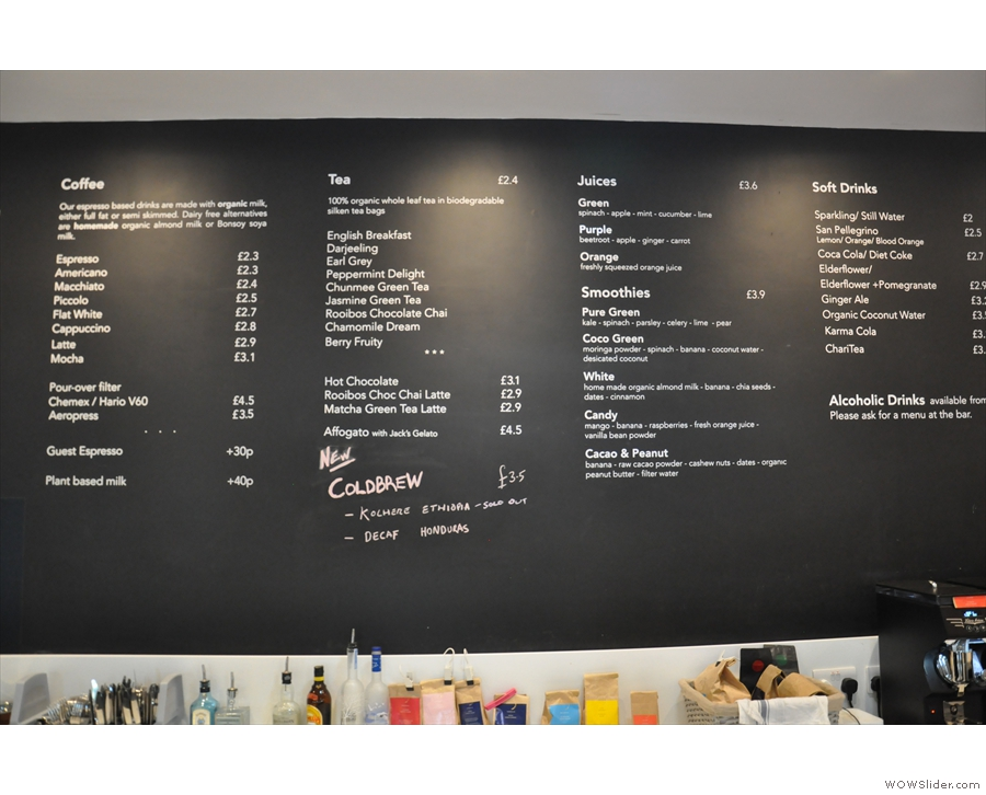 The impressive drinks menu is up above the counter...
