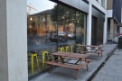 The outside seating is well set back from the road.