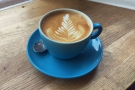 My flat white with some excellent latte art...