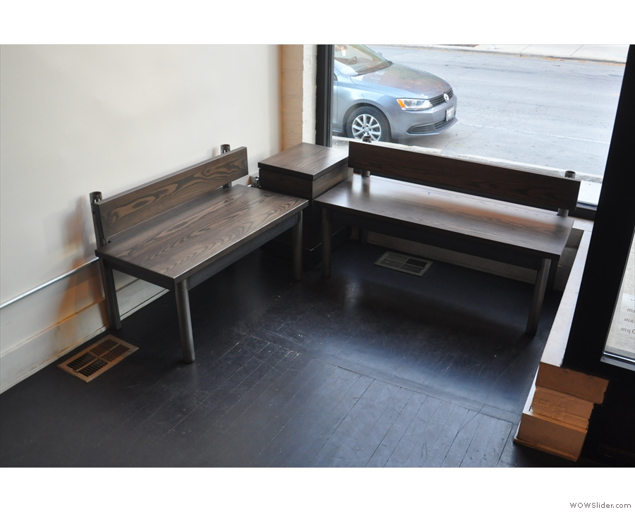 ... and, in the window, these benches. There's a coffee table in the other window.