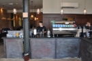 Down to business. The L-shaped counter has espresso machine and grinders facing front...