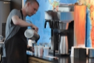 Meanwhile, while all that is going on, this barista is serving three people from the bulk-brew.