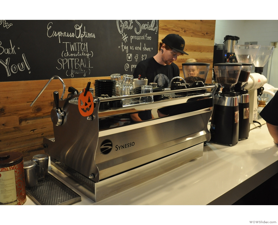 The counter is large and uncluttered. The Synesso espresso machine comes first...