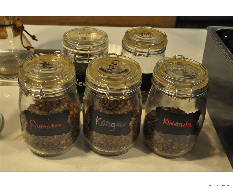 The beans on offer are displayed in glass jars next to the Seraphim.