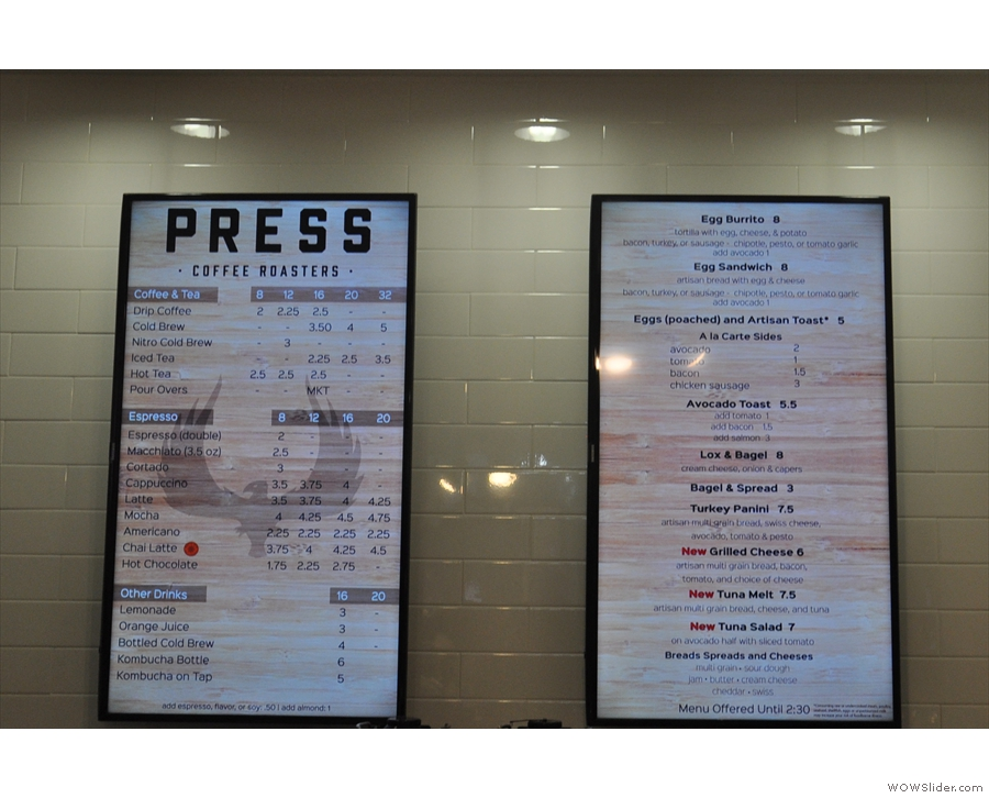 The menus are up on the wall behind the till...