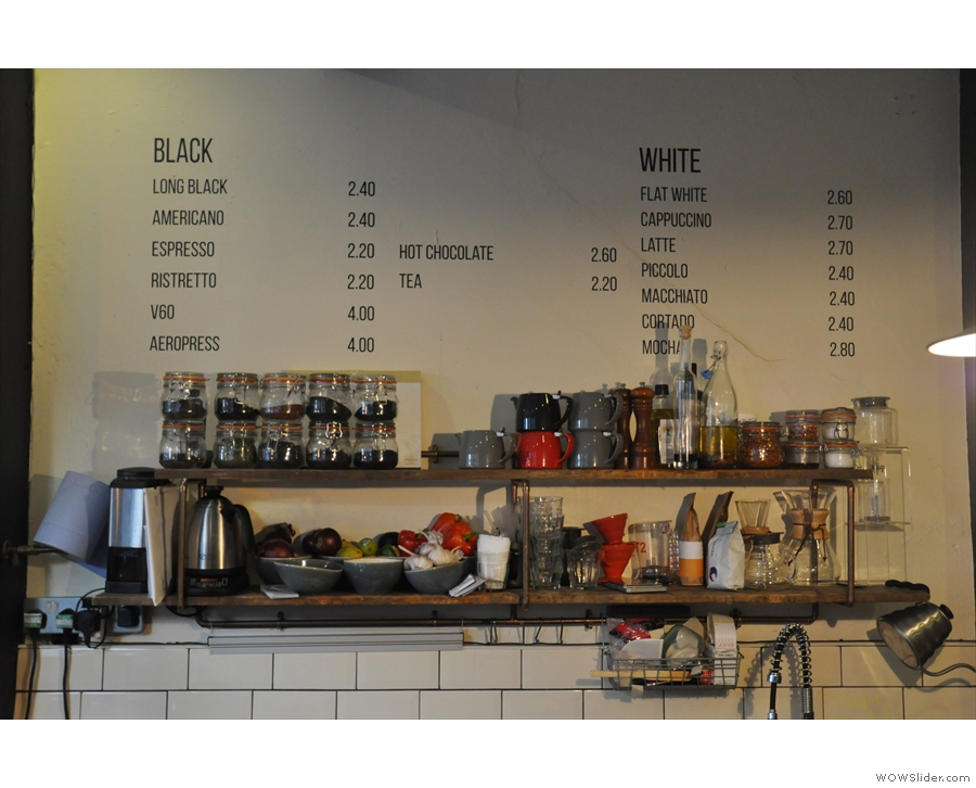 The menu is written on the wall behind the counter: black to the left, white to the right.