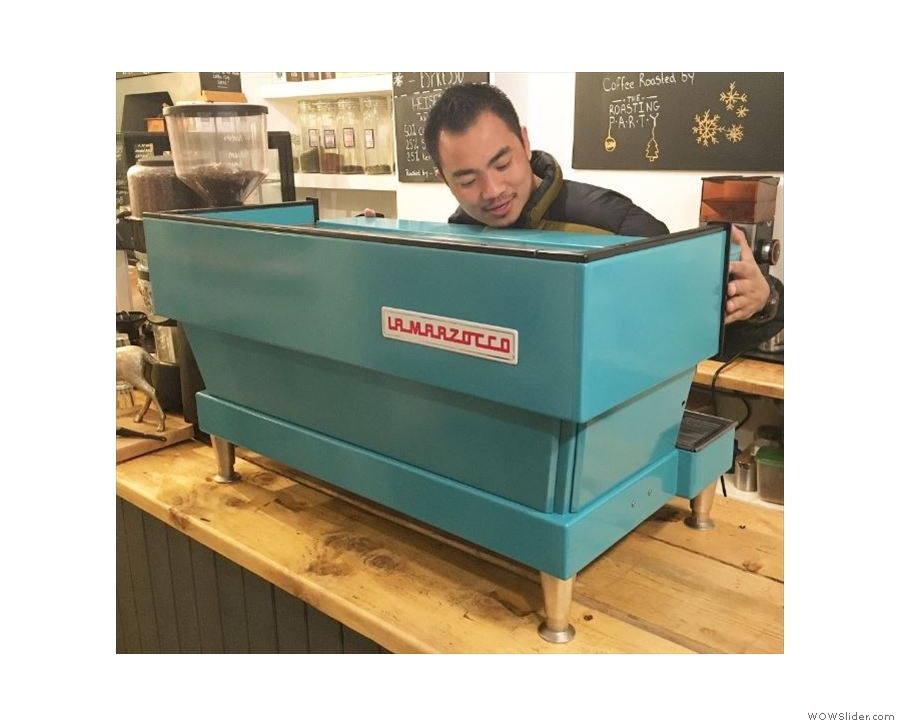 Not that it looks like this any more. Just four days after my visit, a new espresso machine arrived with a custom paint job! Photo by Coffee Lab, with owner Dhan giving it a hug.