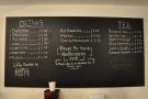The menu is chalked up on the blackboard behind the counter...