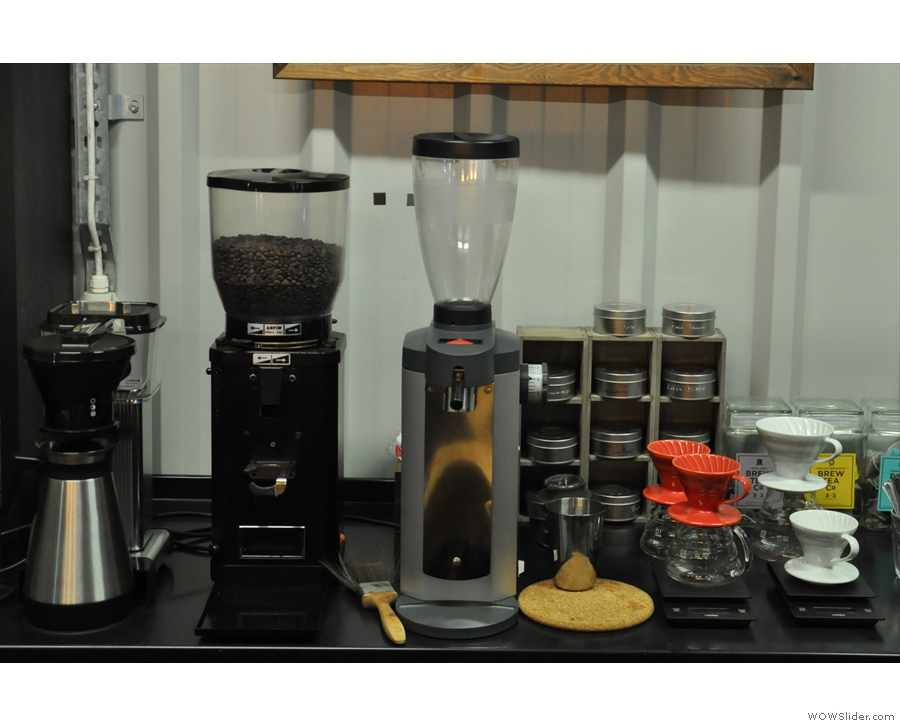 The filter side of the operation, plus the grinder for retail sales, is behind the counter.
