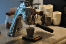 July: espresso extraction from a gleaming Modbar at Modern Society, London.