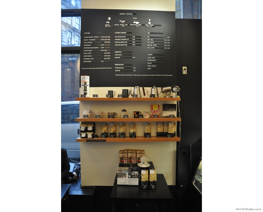 The menu is to the left, above the set of retail shelves.