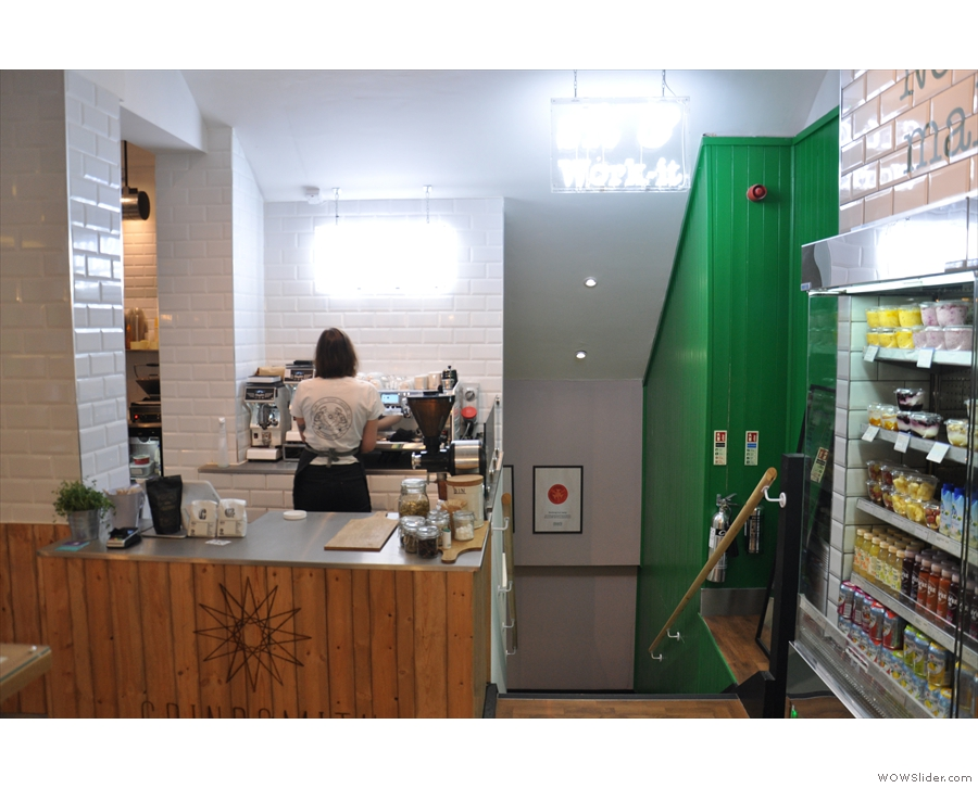 Meanwhile, there is indeed a little coffee bar in the corner opposite the door...