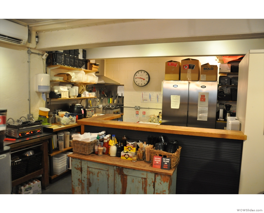 Beyond the counter, there's now a large kitchen, whereas before there was just a wall.