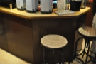 There's been more redistribution of the seating. These stools, which were by the counter...