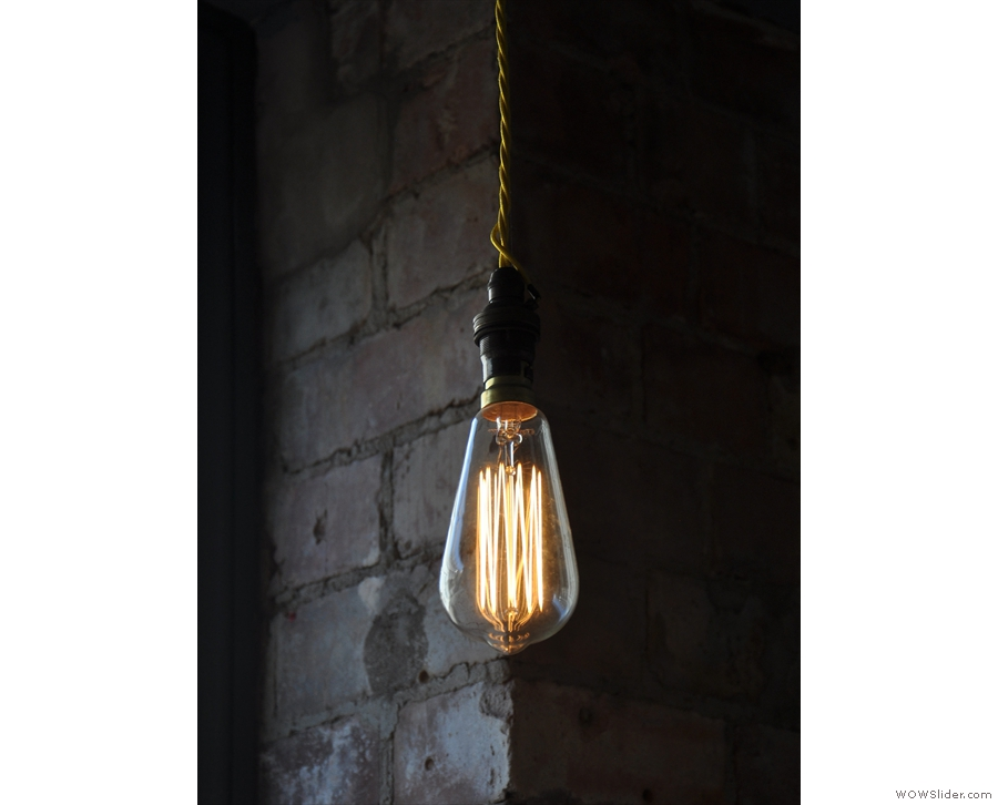 And finally, a single, bare bulb with a backdrop of exposed brick.
