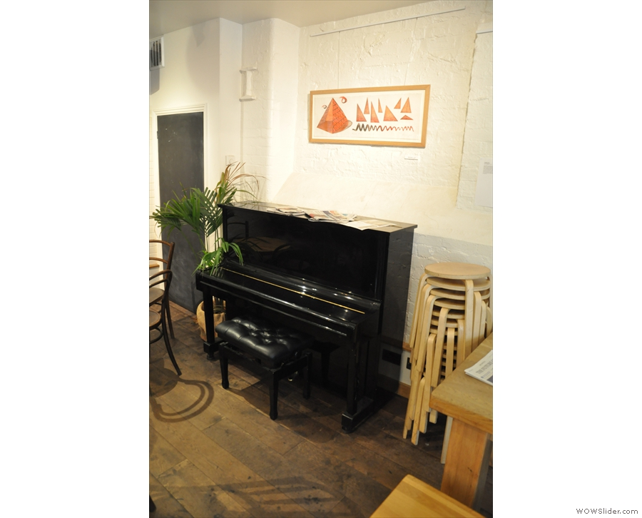 In keeping with its role as a music venue, there is a piano at the back in the main room.