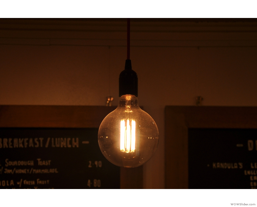 Hot Numbers mixes up the lighting like it mixes up the seating, including this bare bulb.