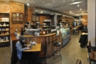 A panoramic view from just inside the door. The coffee end is at the front, beer at the back.