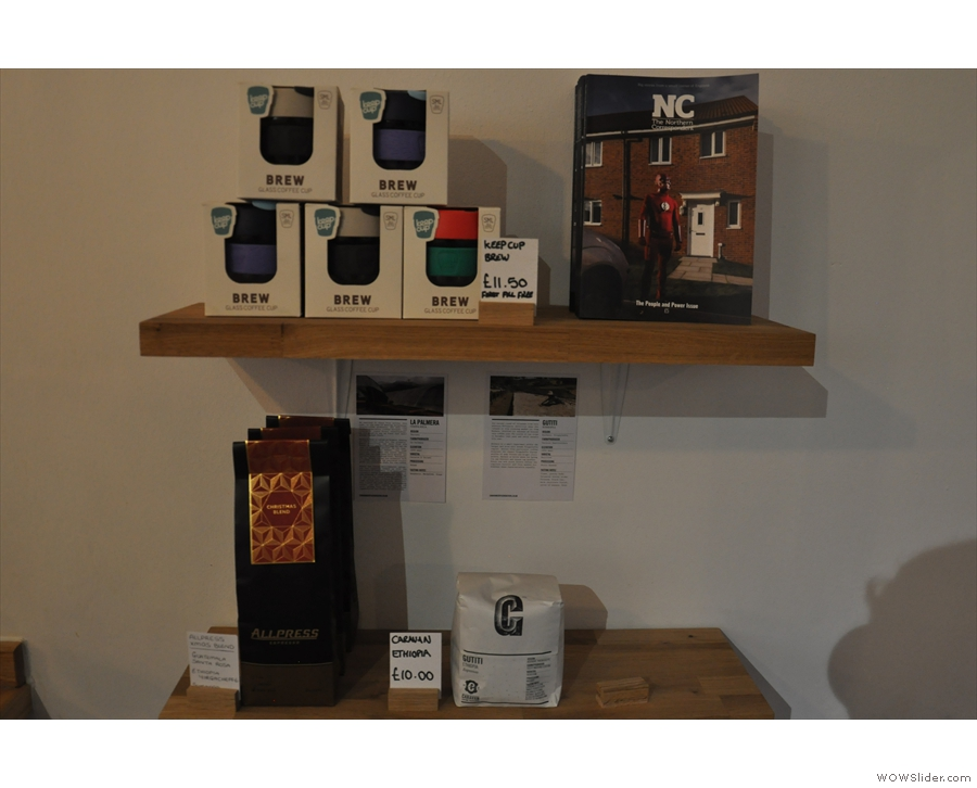 This shelf is at the front, between the window and counter. There's coffee for sale...