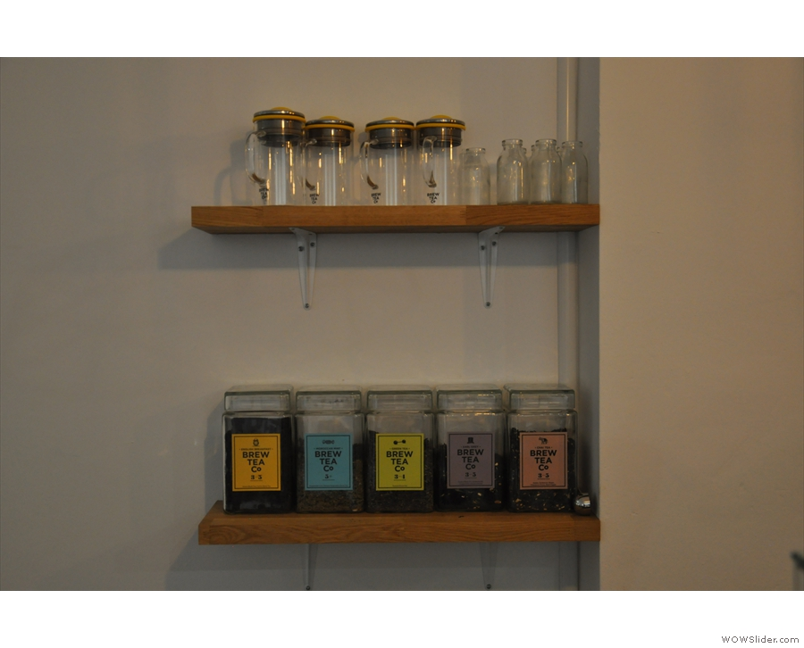 I liked this shelf behind the counter with its tea from Brew Tea Co, plus tea pots of course.