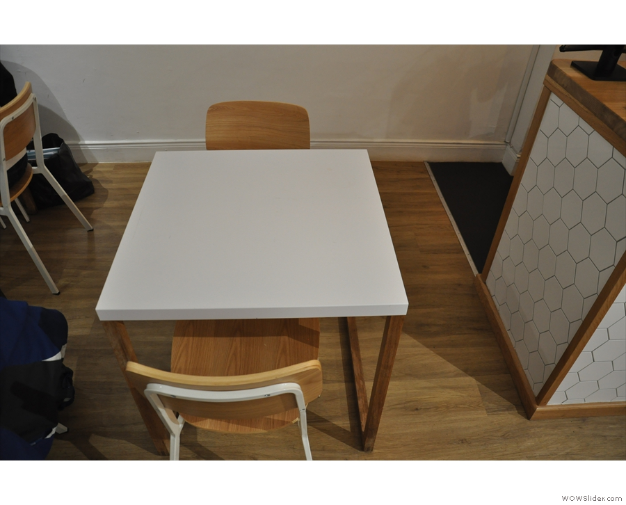 There are more to the right, with this two-person table in the between them & the counter.