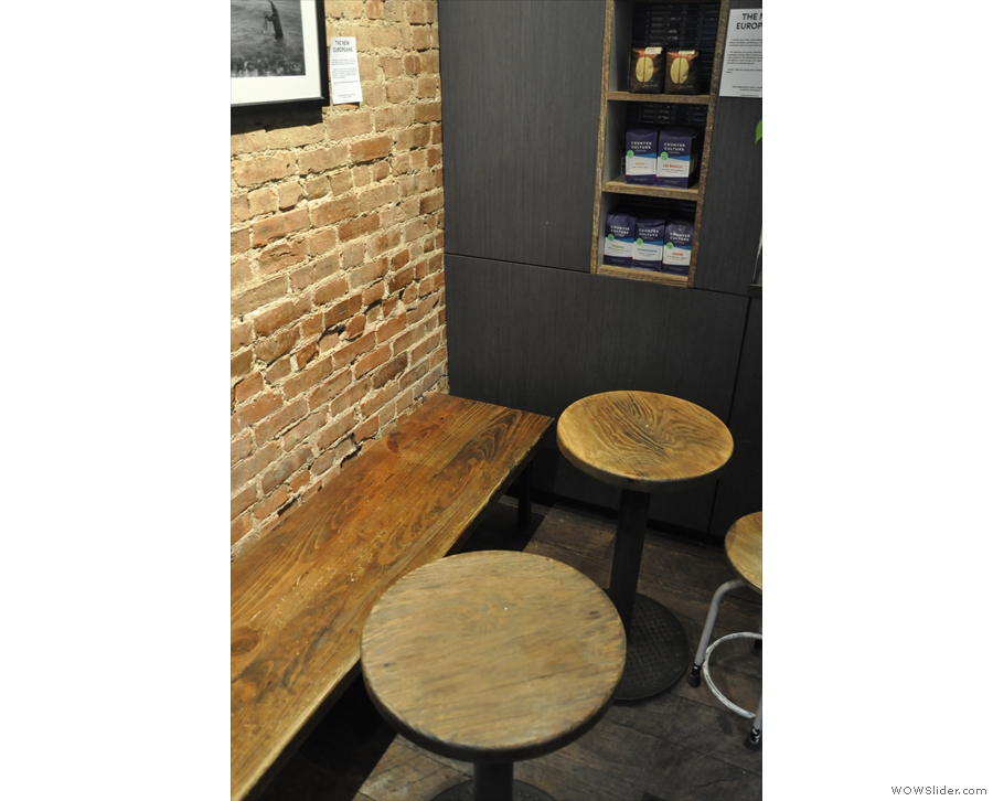 ... which runs the length of the wall. What look like they might be stools are in fact tables.