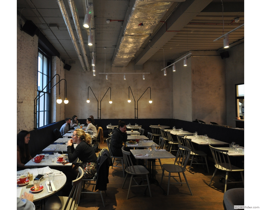 ... who will be happy to seat you in London Grind's dining room. This stretches out ahead...