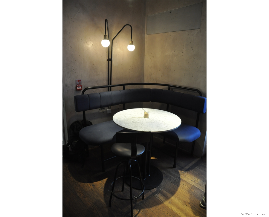 There's plenty of cafe-style seating here, incuding this round table to the left of the door.