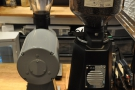 There are a pair of grinders, filter on the left, espresso on the right...