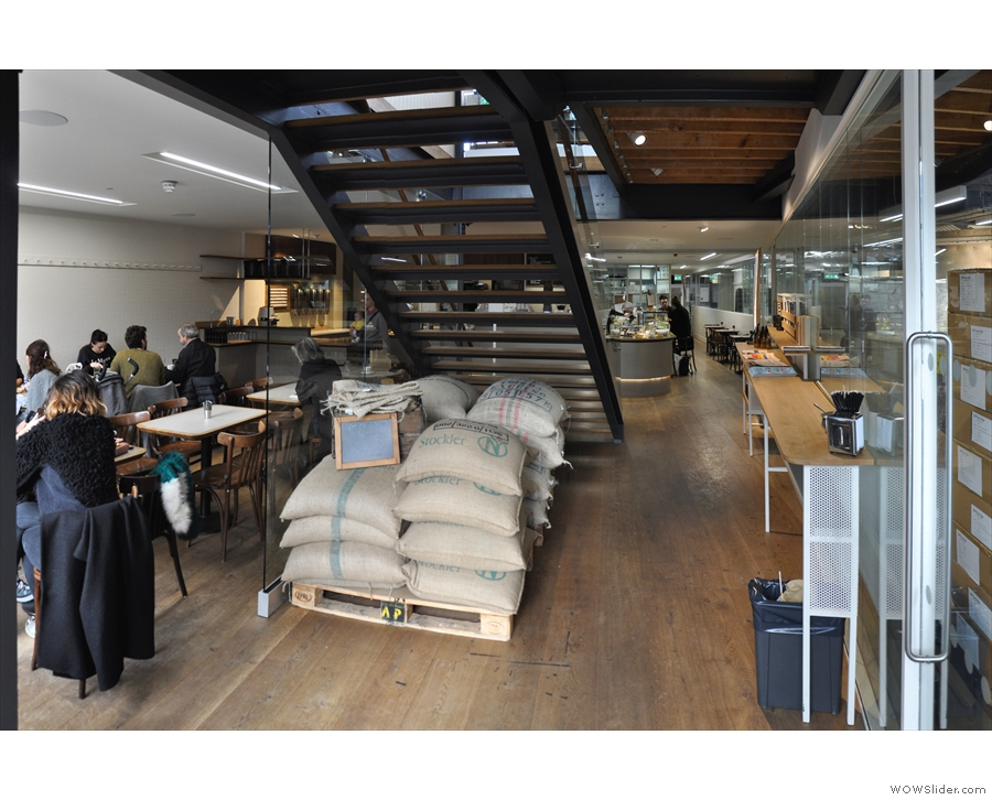 Stepping inside, the site is both a cafe (ahead and to the left) and a roastery (to the right).