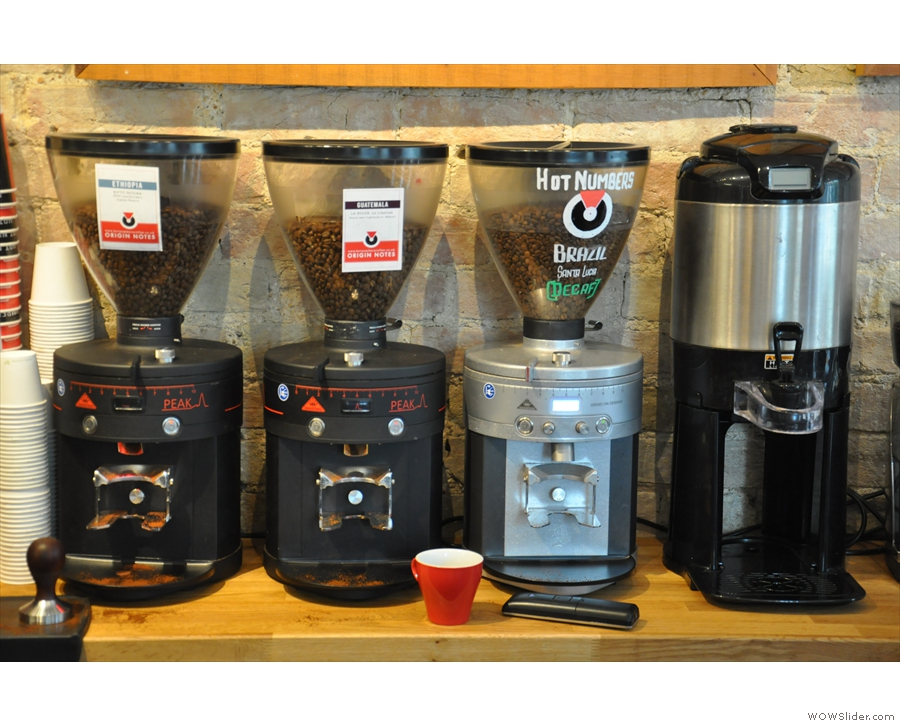 The espresso grinders: two single-origins and one decaf, plus the bulk-brew flask.