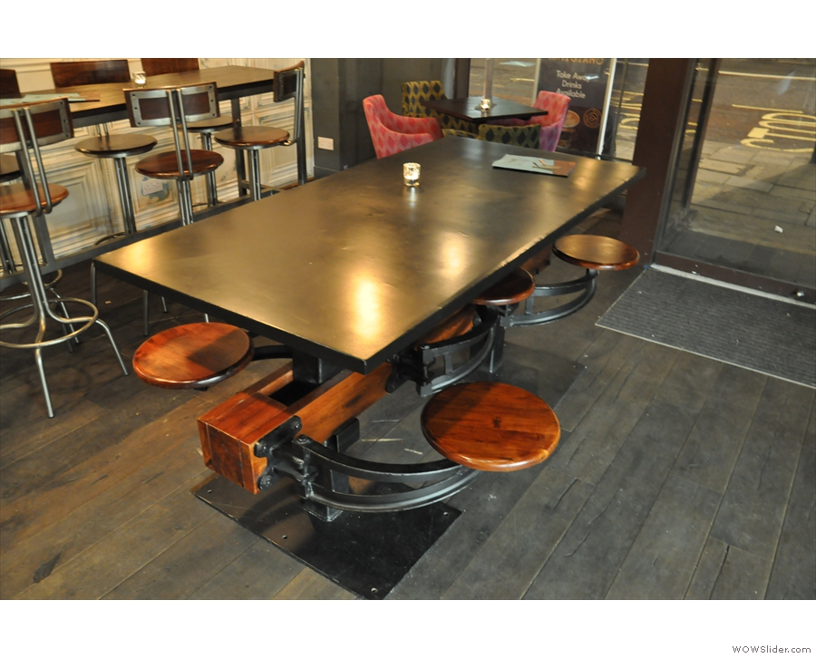 This table with attached bar stools is a good example :-)