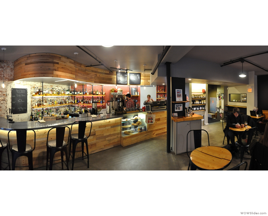 A panorama from just inside the door, showing the bar on the left, coffee at the back.