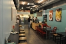 Hummus Bros./Silhouette is long and thin, with seating down either side...