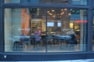 Looking in from the outside: one of two seating areas in the new George Howell coffee shop.