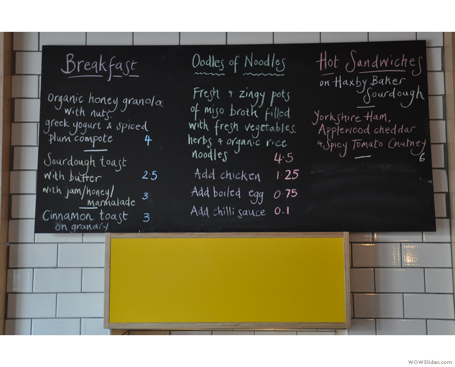 ... and the food menu (on the left-hand wall behind the counter).