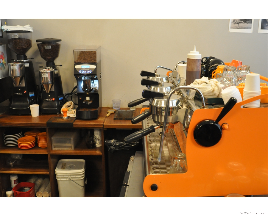 The Synesso espresso machine is in Café Grumpy colours, the grinders off to one side.