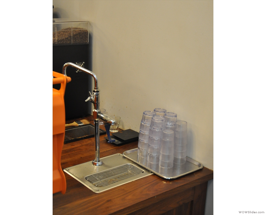 If you're looking for water, it's tucked away at the front of the counter by the Synesso.