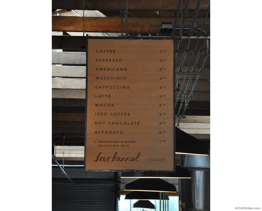 The main coffee menu hangs from the ceiling above the counter...