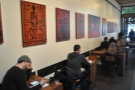 ... followed by two-person tables. Check out the artworks on the wall.