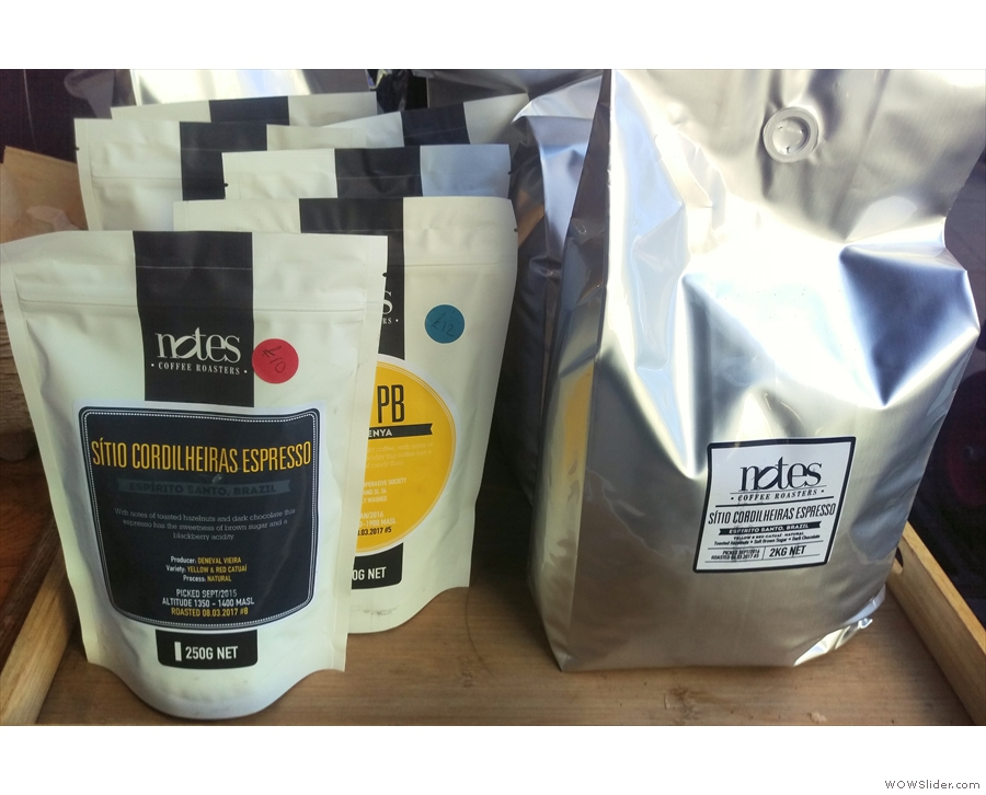 You can also buy retail bags of the coffee (left) while the coffee in the hopper's on the right.