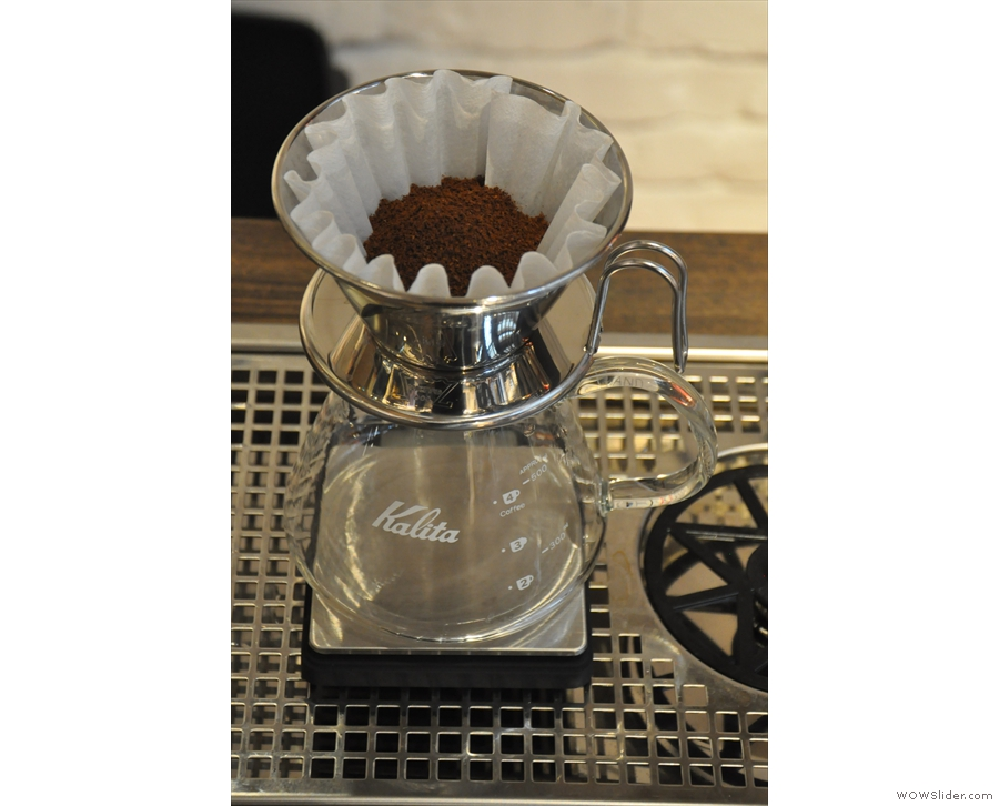 The ground coffee in filter paper, ready to go. [H]AND uses handmade Kalita Wave filters.