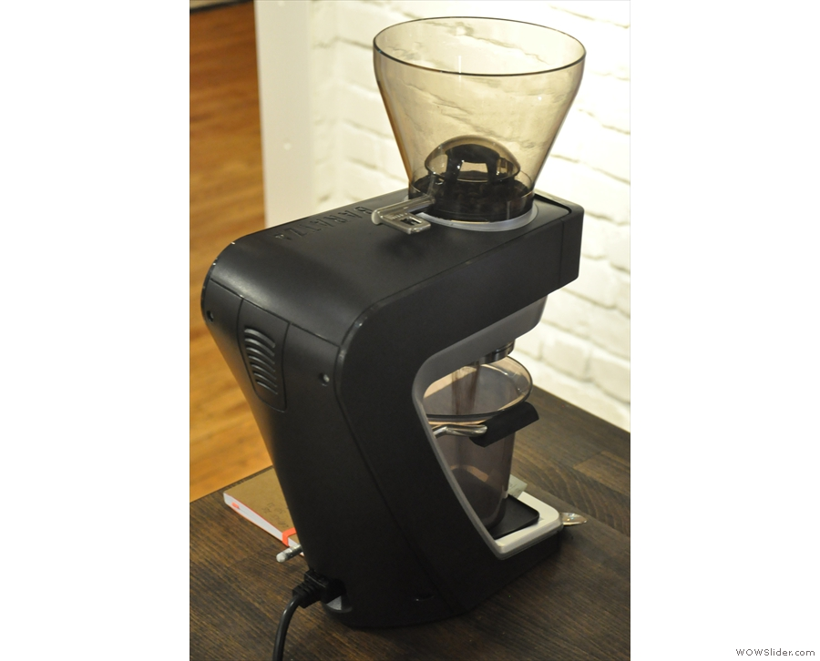 The beans are pre-weighed in small, red boxes & ground on demand in the Baratza grinder.