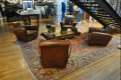 ... four sumptuous armchairs, clustered around a coffee table, seen here from [H]AND.