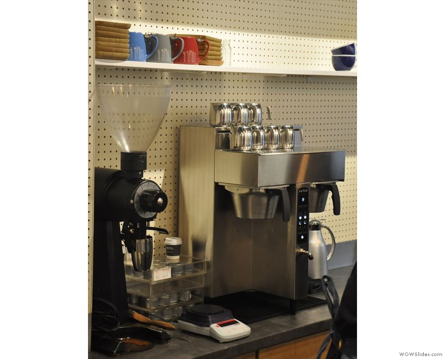 There's a batch-brewer and an EK-43 grinder. The Aeropresses are made on the counter.